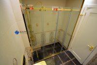 Altın sarısı duşakabin